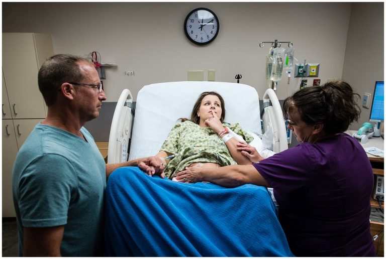 Just before delivery, mom pauses to center herself