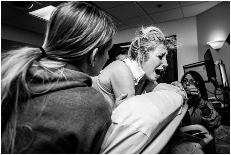 Mom roars during a contraction of her un-medication birth